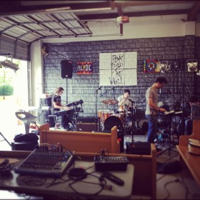 Indie rock band recording in their garage